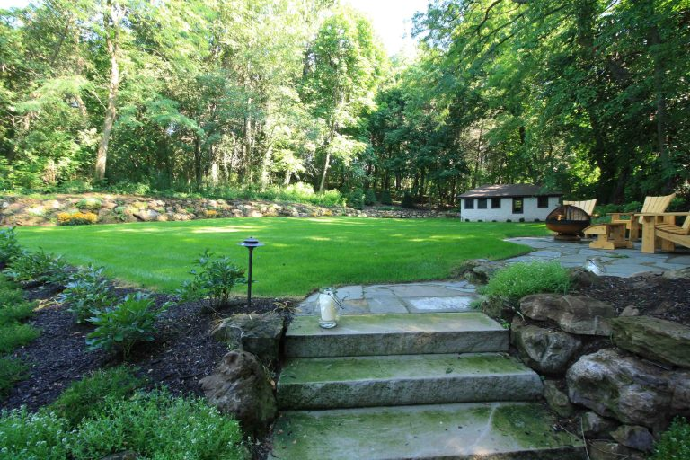 Boulders used for retaining a slope Brighton NY