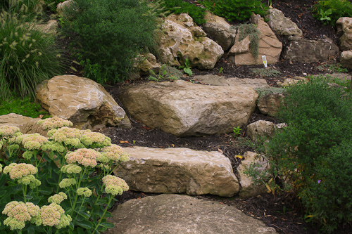 Informal natural stone steps using boulders in Webster NY