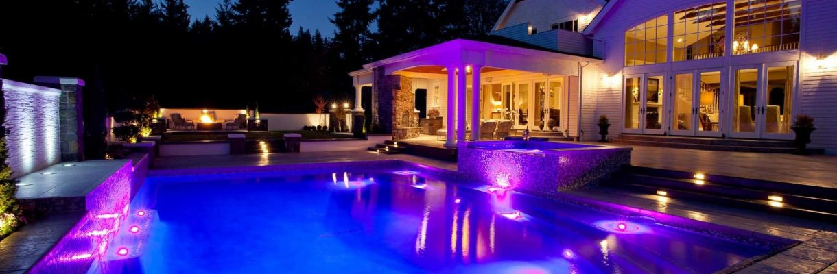 High quality inground pool installation includes outdoor living area