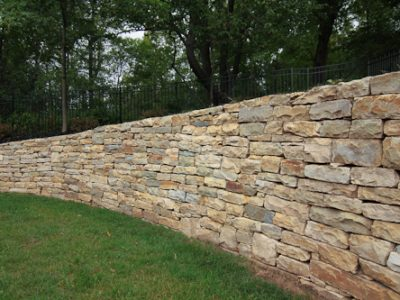 Natural Stone used for installing a pool on a sloped yard in Rochester NY