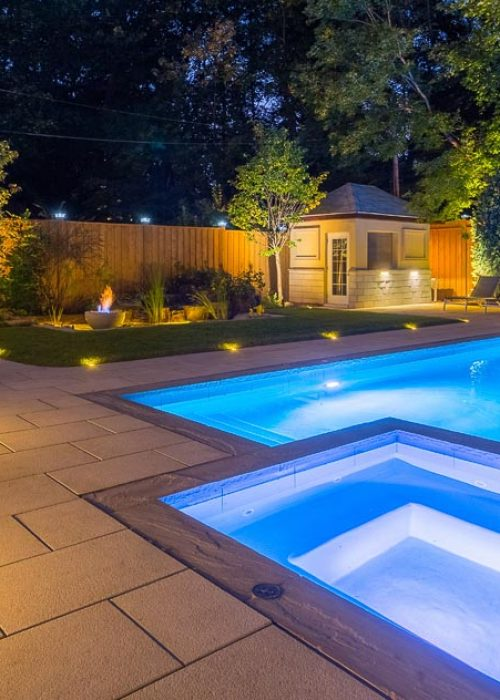 inground pool integrated into backyard living space