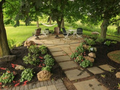 Backyard Makeover using natural flagstone for a patio in Rochester NY